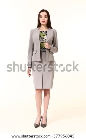 indian asian eastern brunette business executive woman with straight hair style in official gray suit high heels shoes stand full body length isolated on white - stock photo