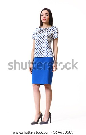 indian asian eastern brunette business executive woman with straight hair style in printed floral blouse and blue mini skirt high heels shoes full length body portrait standing isolated on white - stock photo