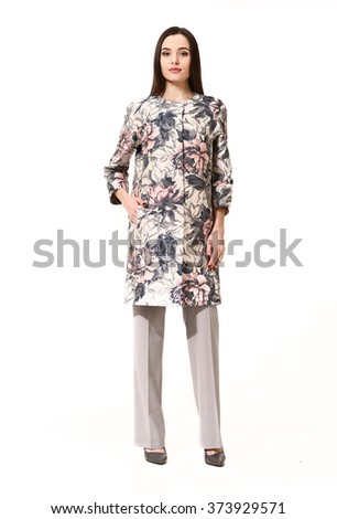 indian asian eastern brunette business executive woman with straight hair style in printed floral trench coat full body length portrait isolated on white - stock photo