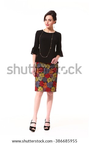 indian asian eastern brunette business executive woman with straight hair style in printed summer patch work skirt and black blouse high heel shoes standing full body length isolated on white - stock photo