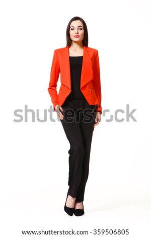 indian asian eastern brunette business executive woman with straight hair style in red jacket and black trousers high heels shoes full length body portrait standing isolated on white - stock photo