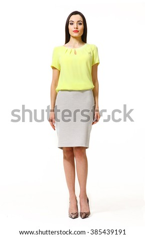 indian asian eastern brunette business executive woman with straight hair style in yellow t-shirt and skirt high heels shoes full length body portrait standing isolated on white - stock photo