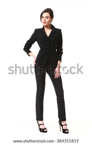 indian asian eastern brunette business executive woman with updo hair style in two pieces jacket and trousers suit high heels shoes full length body portrait standing isolated on white - stock photo