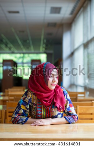 Indian, Asian girl sitting in library.