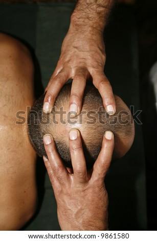 indian ayurvedic oil head massage - stock photo