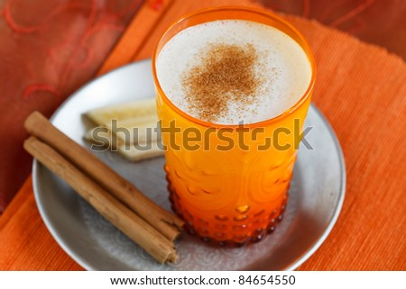 Indian banana lassi served with cinnamon. - stock photo