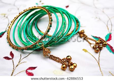 Indian bangles on silk fabric - stock photo