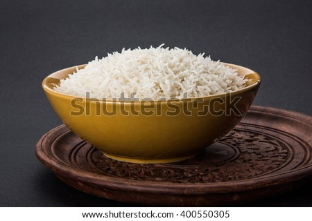 indian basmati rice, pakistani basmati rice, asian basmati rice, cooked basmati rice, cooked white rice, cooked plain rice in bowl over black background - stock photo