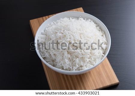 indian basmati rice, pakistani basmati rice, asian basmati rice, cooked basmati rice, cooked white rice, cooked plain rice in round white bowl - stock photo