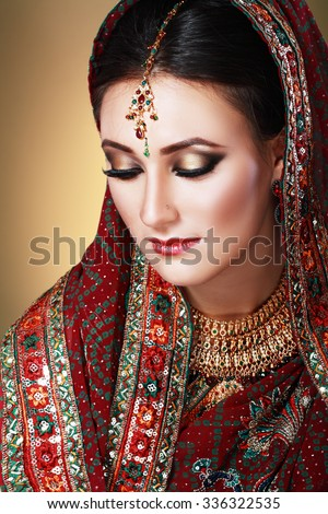 Indian beauty face close up beautiful eyes with perfect make up wedding - stock photo