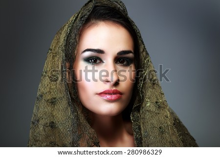 Indian beauty face close up perfect make up headscarf. Series. young beautiful brunette in traditional national dress - stock photo