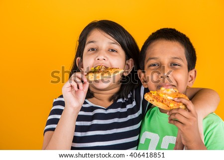 indian boy and girl eating pizza, asian kids eating pizza