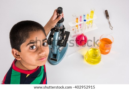 indian boy and microscope, asian boy with microscope, Cute little kid holding microscope, small indian boy and science experiment, boy doing science experiments