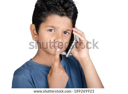 indian boy speaking on mobile phone - stock photo
