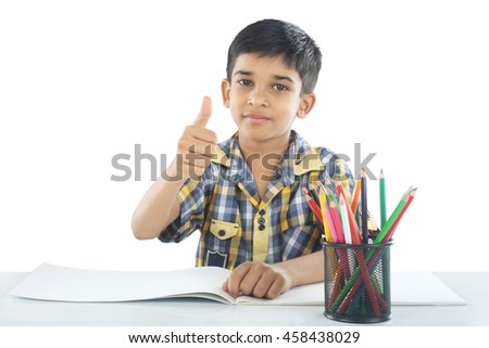 Indian boy with drawing note and pencil - stock photo
