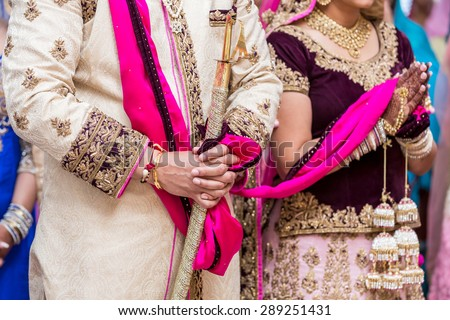 Indian bride and groom in a temple during the wedding ceremony. - stock photo