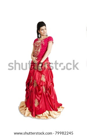 Indian Bride wearing red bridal gown isolated on white. - stock photo