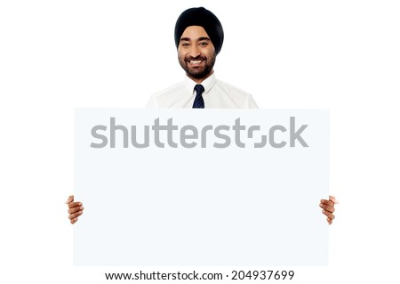 Indian business executive holding blank sign board - stock photo