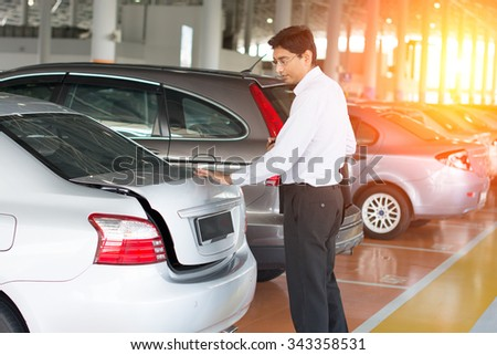 indian business in car park - stock photo