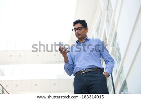 indian business male holding a phone - stock photo