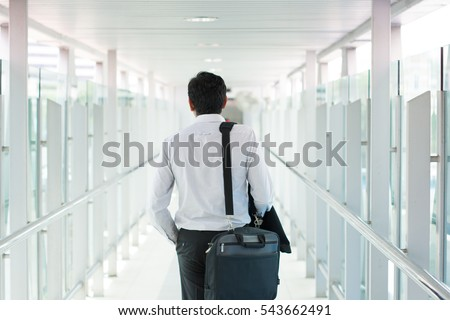 indian business male walking at airport