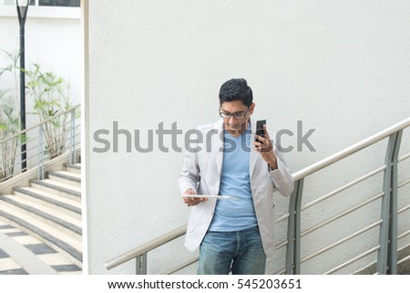 indian business male with a tablet computer
