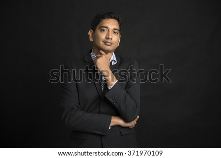 indian business male with black background  - stock photo