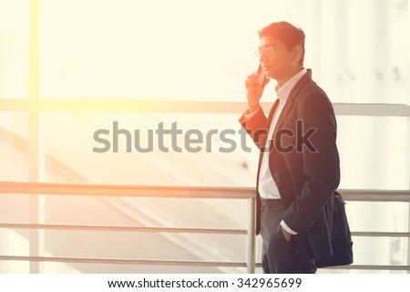 indian business man at airport terminal - stock photo