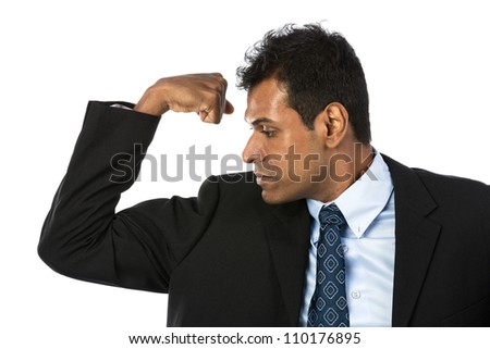 Indian business man flexing his bicep. Concept about power and strength.