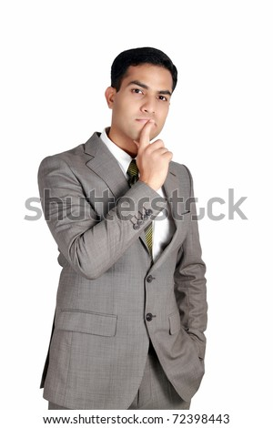 Indian business man in thinking pose. Isolated on a white background. - stock photo