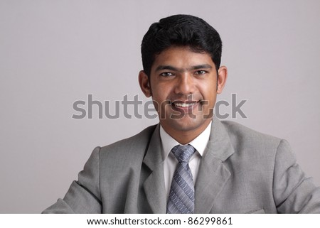 Indian business man posing to the camera. - stock photo
