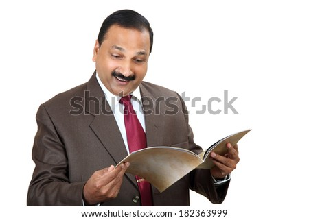 Indian business man reading some exciting news isolated on white background. - stock photo