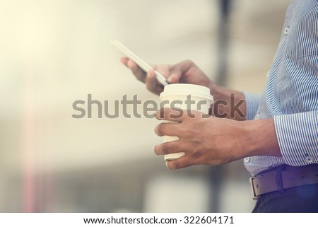 indian business man using phone and coffee in the morning - stock photo