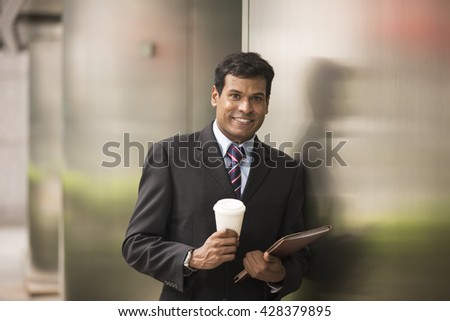 Indian business man with a tablet computer. Asian business man using digital tablet computer. - stock photo