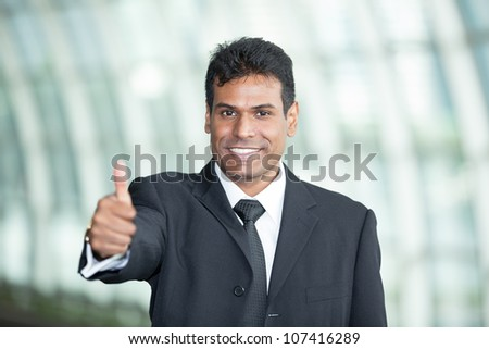 Indian Business man with his Thumb Up in agreement