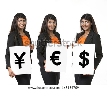 Indian business woman holding currency symbols saying word 'YES' - stock photo