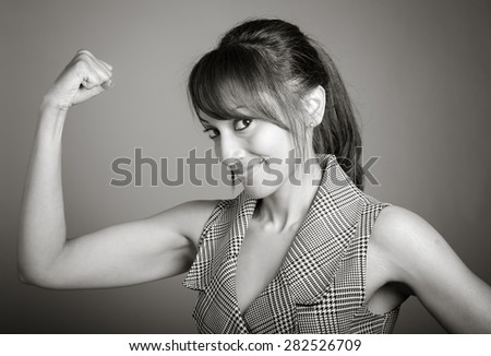 Indian business woman posing in studio isolated on a background, black and white image - stock photo