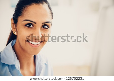 Indian business woman pretty smiling office - stock photo