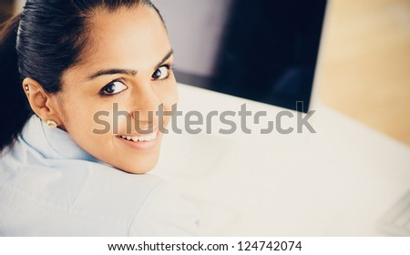 Indian business woman pretty vintage style portrait smiling office