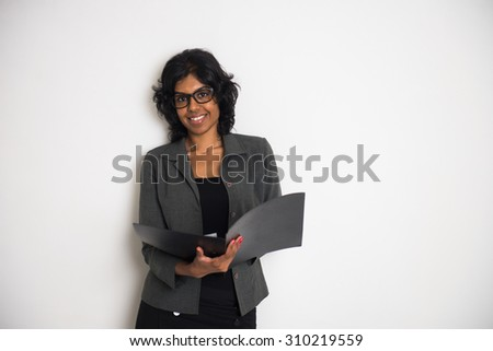 indian business woman with folder - stock photo