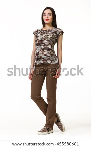 indian business woman with straight hair style in khaki summer blouse trousers and trainers  full body length isolated on white - stock photo