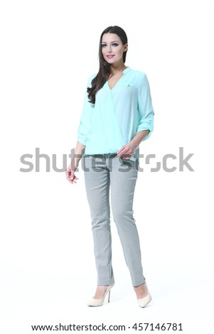 indian business woman with straight hair style in summer white blouse and trousers high heel shoes full body length isolated on white - stock photo