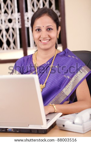 Indian business woman working in the office - stock photo