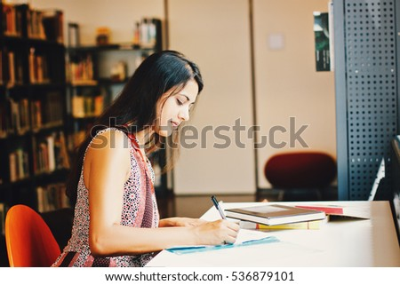 Indian business woman working writing