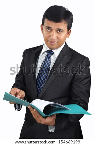 Indian businessman checking the documents - stock photo