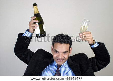 Indian businessman having fun at a party - stock photo
