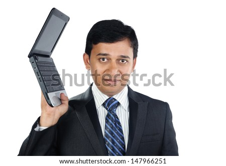 Indian Businessman holding a Laptop - stock photo