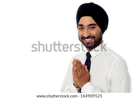 Indian businessman showing welcomes gesture - stock photo