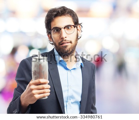 indian businessman with a beer - stock photo