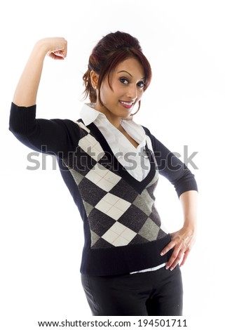 Indian businesswoman flexing biceps and smiling - stock photo